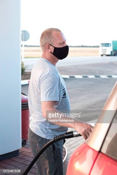 european man protective black mask refueling