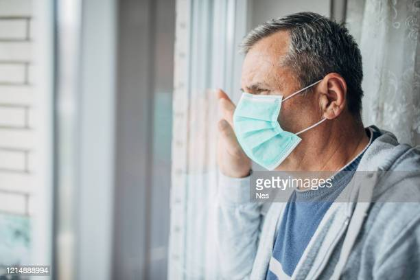 a man in isolation because of a virus - pandemic illness stock pictures, royalty-free photos & images