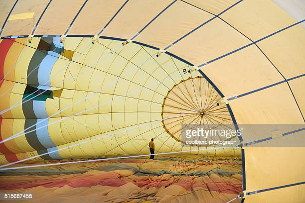 a man preparing hot air balloon at Cappadocia