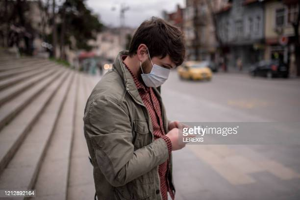 a man with a safety mask - pollution mask stock pictures, royalty-free photos & images