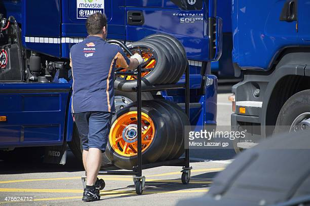 a mechanic walks in paddock with the Michelin tires during the Michelin tires test during the MotoGp Tests At Mugello at Mugello Circuit on June 1...