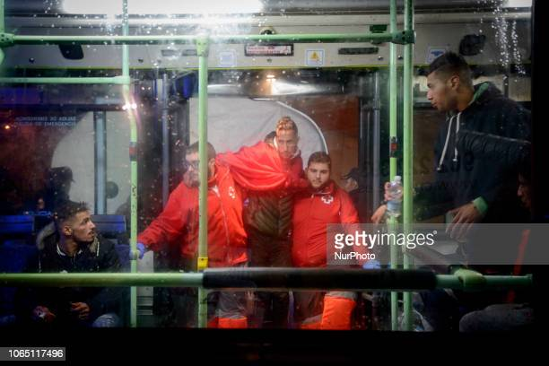 a migrant being helped by the red cross staffs to get inside of the bus to be transferred to a center Malaga The Spaniard Maritime vessel rescued in...
