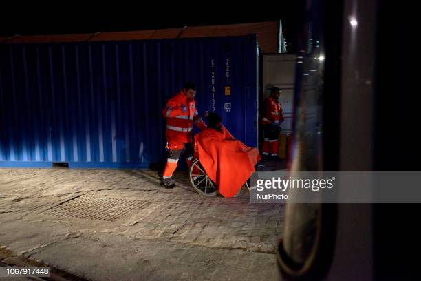 a migrant being transferred with the help of a wheelchair on November 28 Malaga