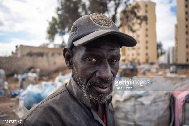 a migrant worker in libya - migrant worker stock pictures, royalty-free photos & images