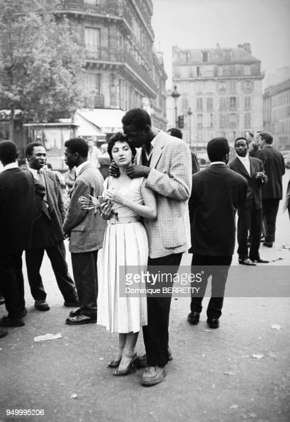 a mixed couple in Saint Germain des Pres 6th arrondissement in Paris France in the fifties