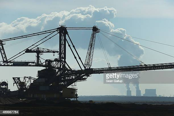 A a mobile machine called a spreader depositing soil removed from one end of the Welzow Sued openpit lignite coal mine to allow excavators to reach...