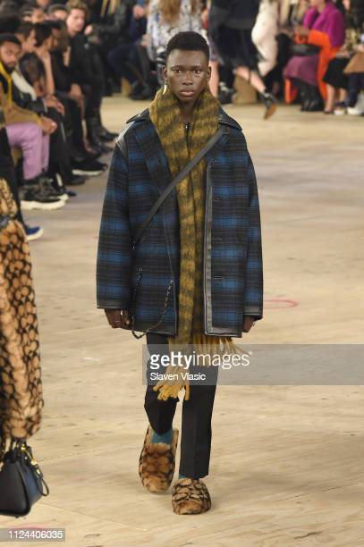 a model walks the runway at Coach 1941 fashion shoe at the NYSE on February 2019 during New York Fashion Week on February 12 2019 in New York City