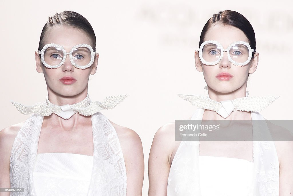 a model walks the runway during Acquastudio show as part of Sao Paulo Fashion Week Summer 2013/2014 on March 19, 2013 in Sao Paulo, Brazil.