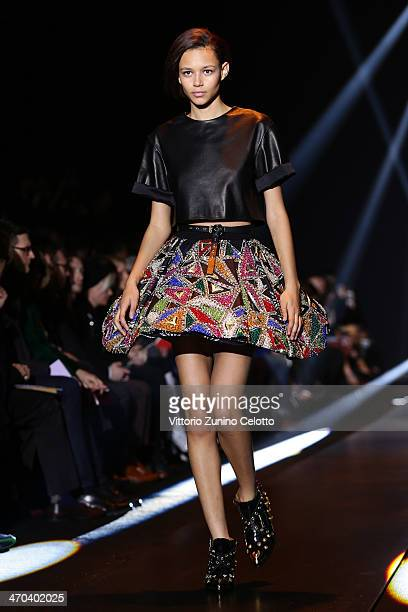 a models walks the runway at Fausto Puglisi fashion show during Milan Fashion Week Womenswear Autumn/Winter 2014 on February 19 2014 in Milan Italy