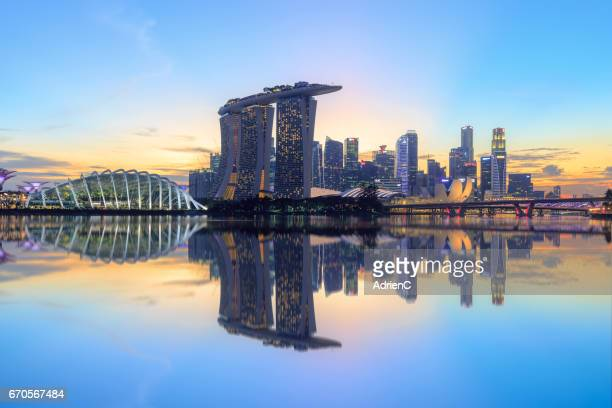 a modern city with reflection during sunset