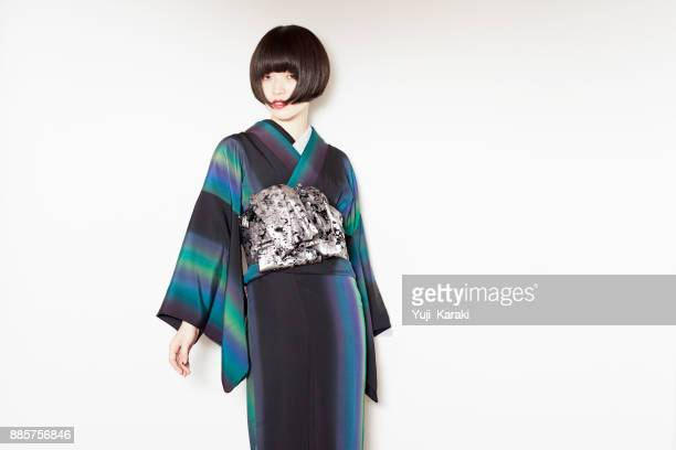 a modern girl in a kimono - kimono stock pictures, royalty-free photos & images