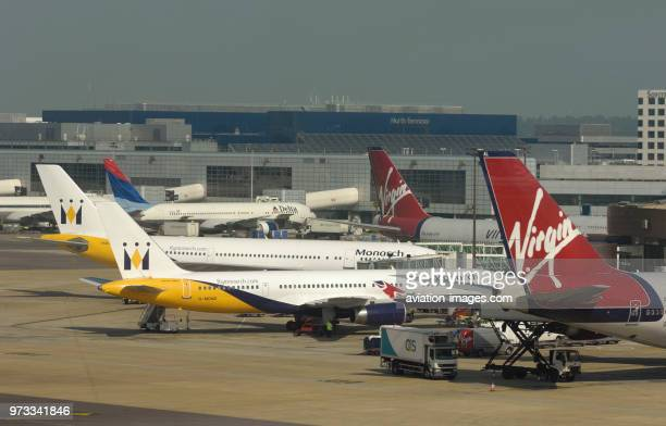 a monarch boeing 757200 airbus a300 with two virgin atlantic 747400s with an ocs catering truck
