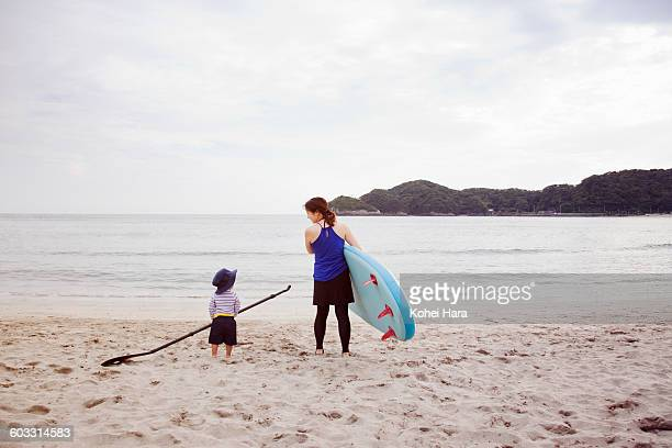 a mother and a baby enjoy water sports in the sea