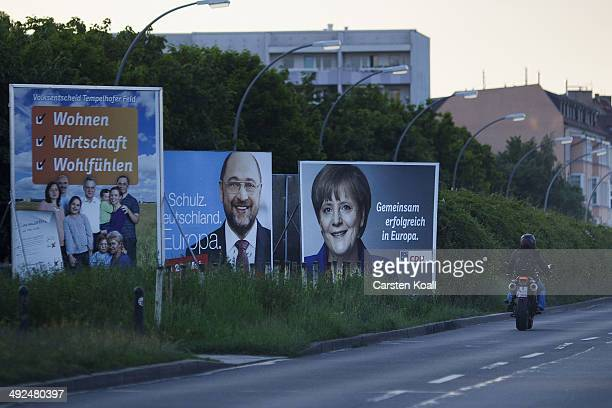 a motocyclist pass election campaign billboards for Martin Schulz a Social Democrat and President of the European Parliament and the German Christian...