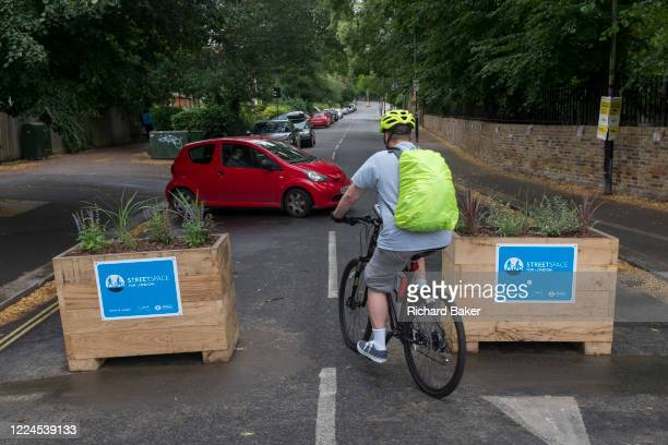 A motorist turns round at the pedestrianised road junction at Carlton Avenue, Court Lane and Dulwich Village which has been blocked off to passing...