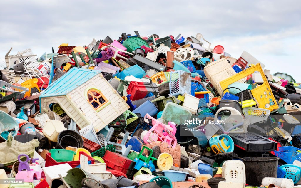 a mountain of plastic goods at a recycling plant : Stock Photo