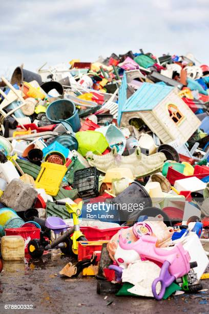 a mountain of plastic goods at a recycling plant
