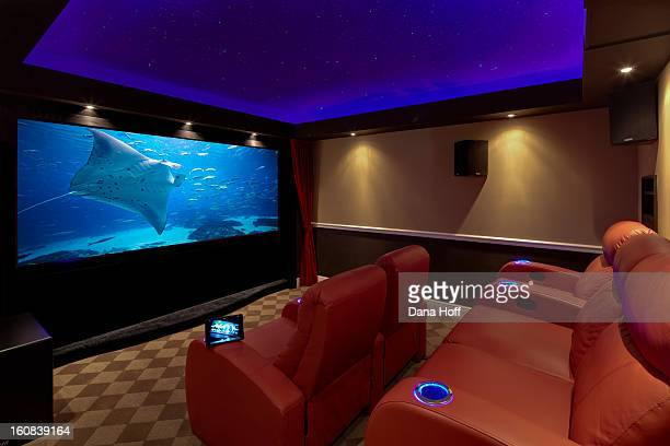 a movie plays on a high end luxury home theater sy