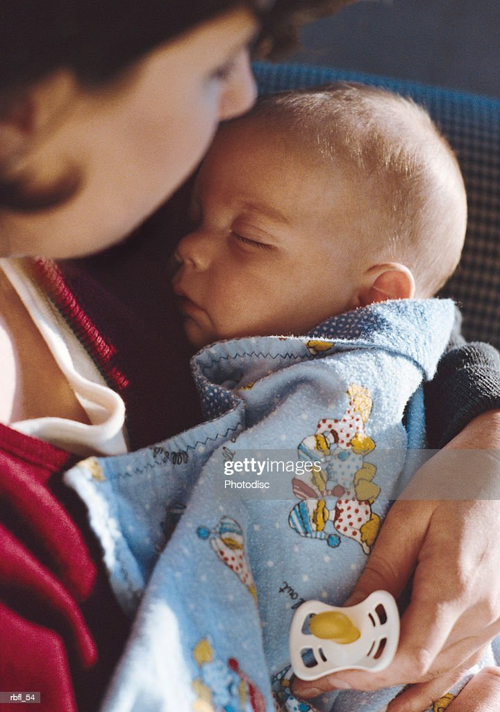 a new mother and her infant rest : Stockfoto