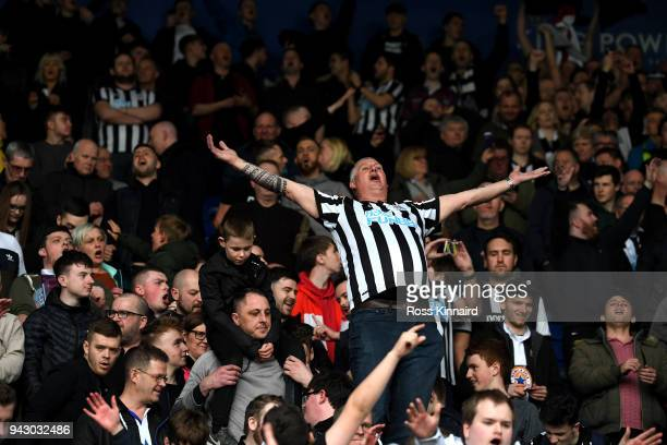a Newcastle United fan celebrates during the Premier League match between Leicester City and Newcastle United at The King Power Stadium on April 7...