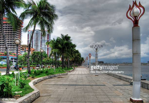 a nice walk on the bay - manila bay stock photos and pictures