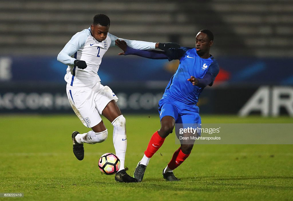 ;a of England U21 holds off Jean-Kevin Augustin of France U21 during the U21 international friendly match between France and England at Stade Robert Bobin on November 14, 2016 in Paris, France.
