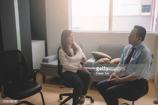 a one to one counseling session with asian chinese female patient - grief stock pictures, royalty-free photos & images