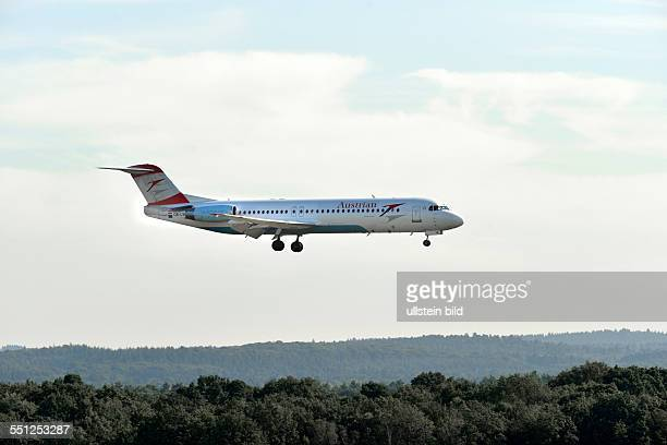 a passenger plane of Austrian airlines on landing at the airport of CologneBonn