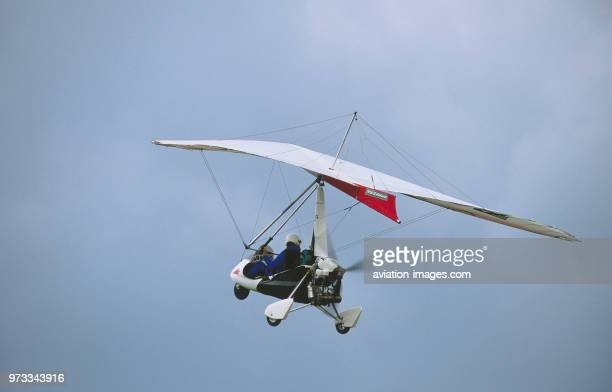 a Pegasus weightshift microlight climbing out after takeoff