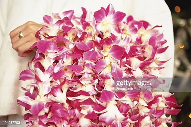 a person holding a lot of lei, front view, hawaii, usa - lei day hawaii stock pictures, royalty-free photos & images
