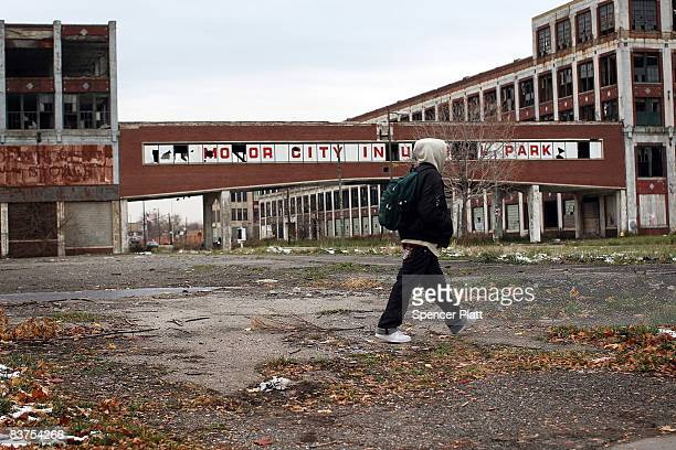 a person walks past the remains of the Packard Motor Car Company which ceased production in the late 1950`s November 19 2008 in Detroit Michigan The...