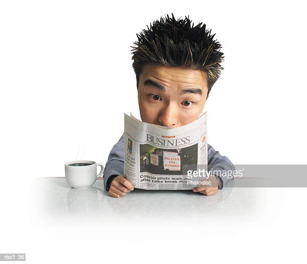 a photo caricature of a young asian man sitting at table with coffee mug and reading newspaper