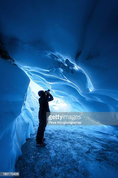 CONTENT] a photographer shooting inside an ice cave formed underneath Matanuska Glacier in Alaska This cave is only accessible in winter