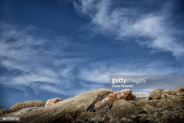 a pile of stones against the sky with clouds