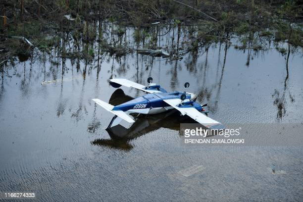 A plane is turned upside down after Hurricane Dorian, September 6 in Marsh Harbour, Great Abaco. - The final death toll from Hurricane Dorian in the...
