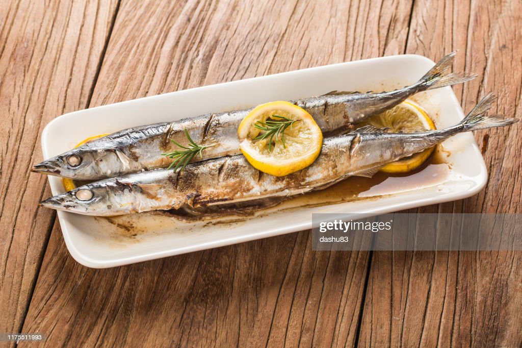 a plate of fresh barbecue saury : Stock Photo