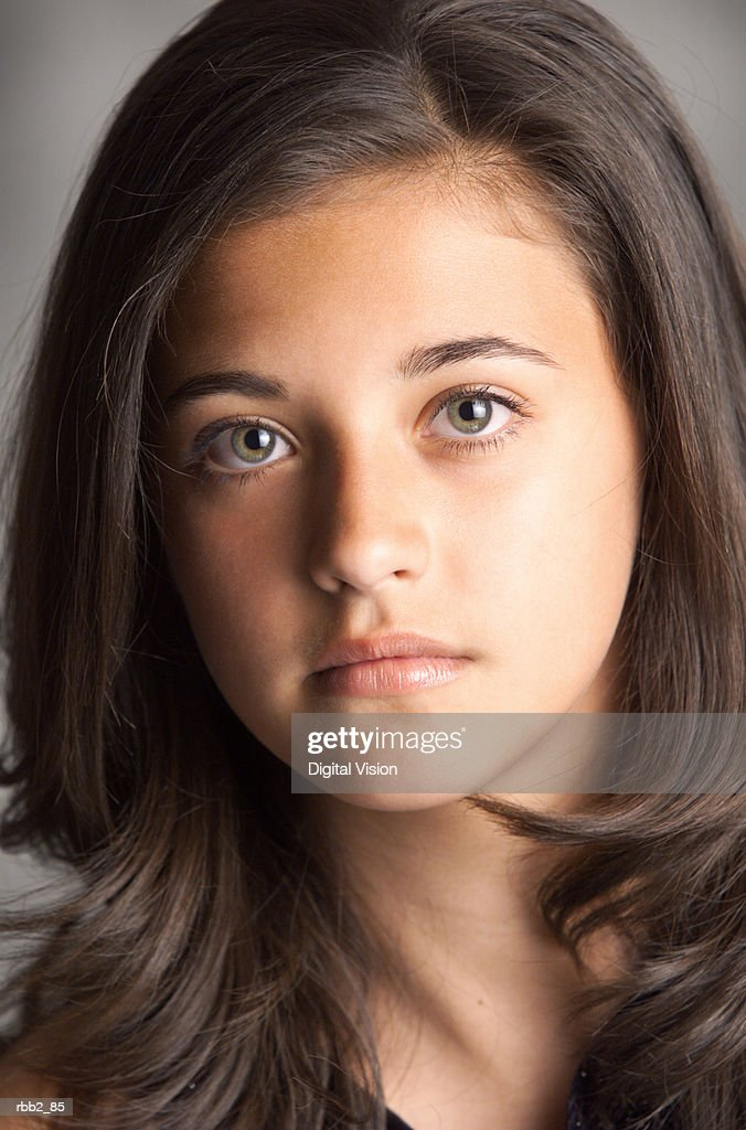 a portrait of a young beautiful ethnic girl looking into camera : Stockfoto