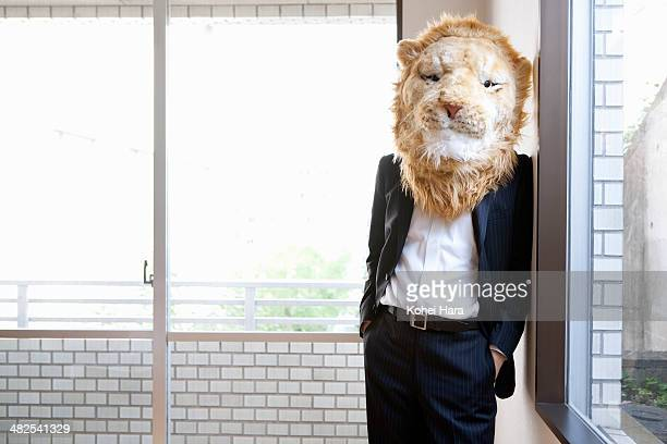 a portrait of business man with lion head