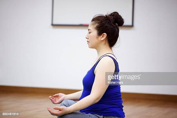 a pregnant woman doing yoga