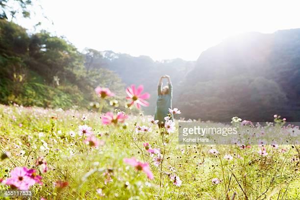 a pregnant woman in flower fields