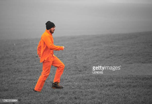 a prisoner during his escape - prisoner stock pictures, royalty-free photos & images