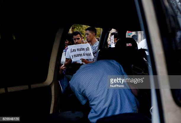 a protester holding a banner during the Demonstration in support to World refugee day in Madrid on September 12 2015