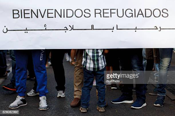 a protester holding a banner welcome refugees during the Demonstration in support to World refugee day in Madrid on September 12 2015