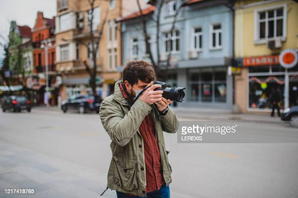 a reporter with a camera on the street - journalist stock pictures, royalty-free photos & images