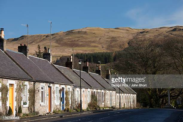 a row of houses along a street - dumfries stock pictures, royalty-free photos & images