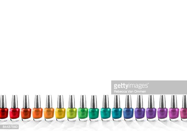 a row of nailpolish arranged in rainbow colours