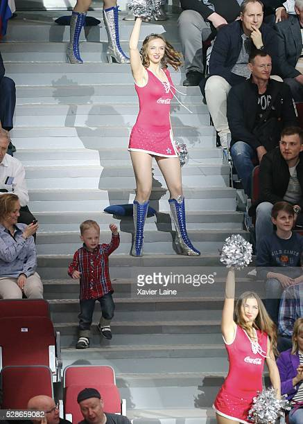 a Russian kids dance with a cheerleader during the 2016 IIHF World Championship between USA and Canada at Yubileyny Sports Palace on May 6 2016 in...