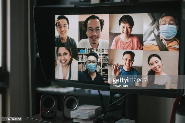 a screen of 8 person online chatting looking at camera discussion from a computer monitor screen at home office