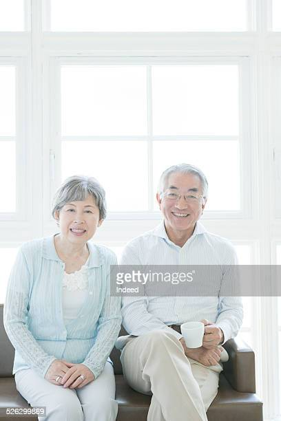 a senior couple sitting on a sofa