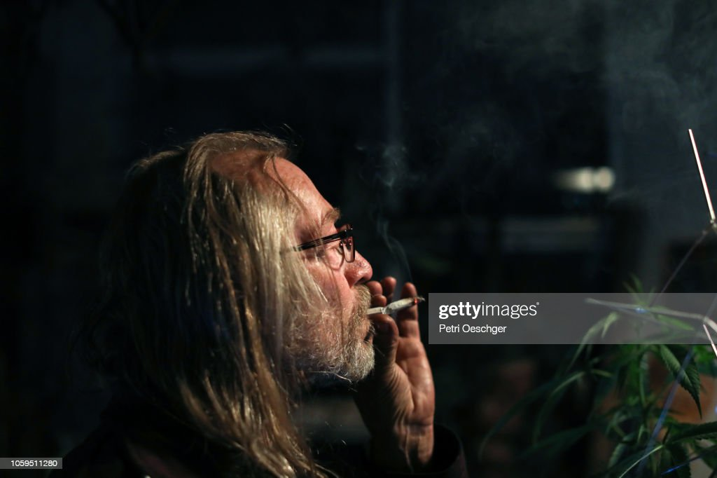 a Senior man smoking a marijuana joint. : Stock Photo